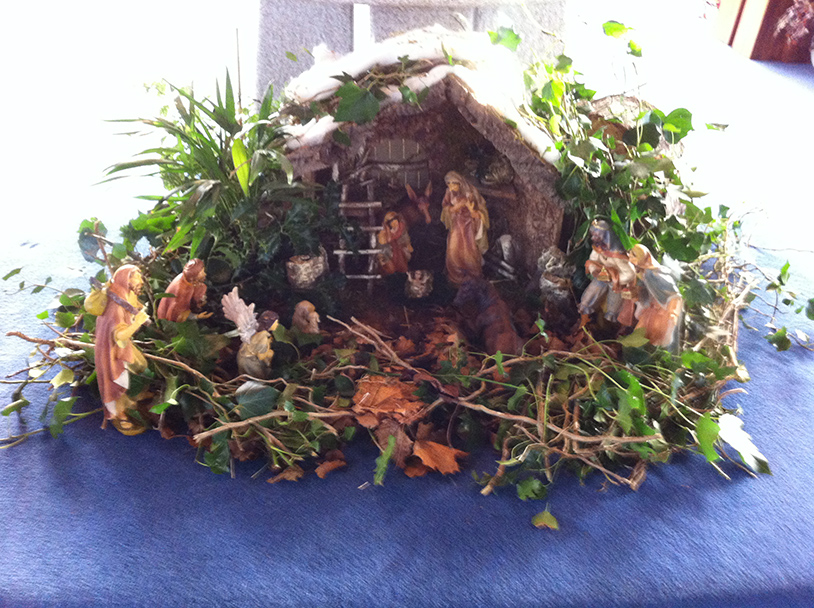 The crib at the foot of the school altar